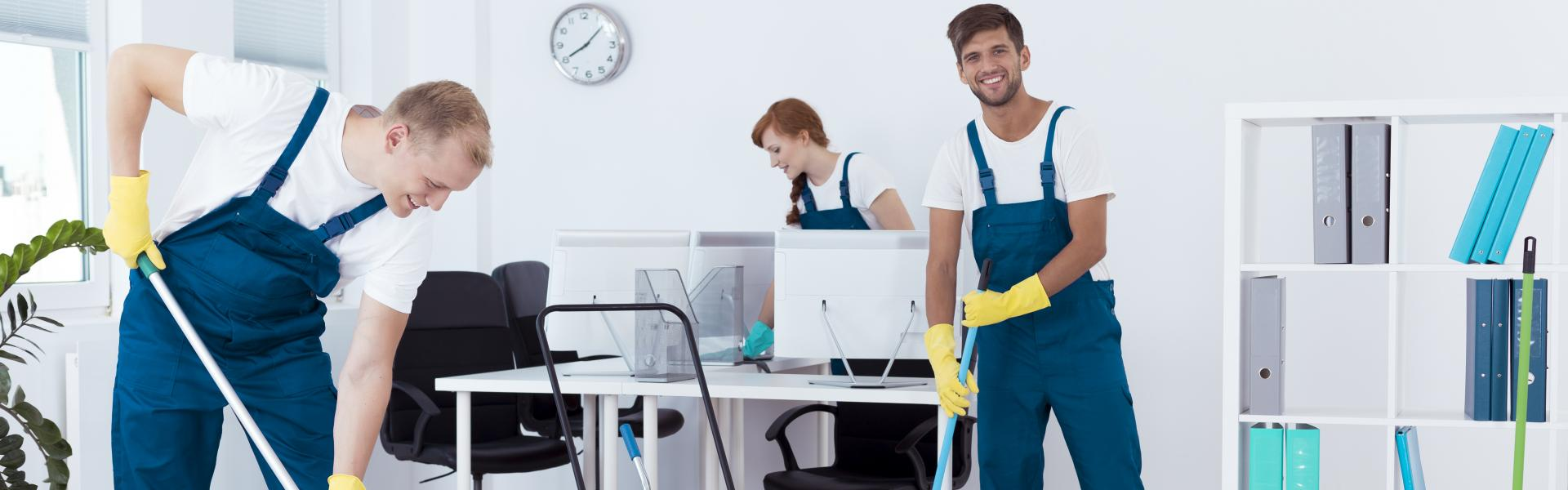 Professional cleaning team cleaning an office